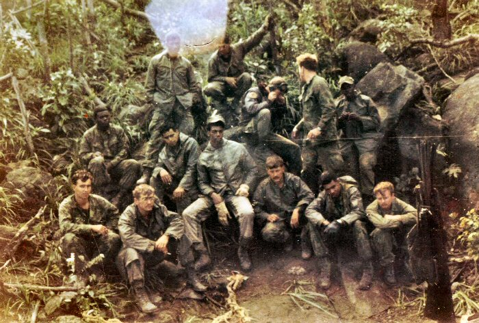 Pictured here in the darkness of the triple canopy which engulfed YK-13 are the seven Purple Foxes and six grunts who were providing security for the ... & Douglas R. Breazeale
